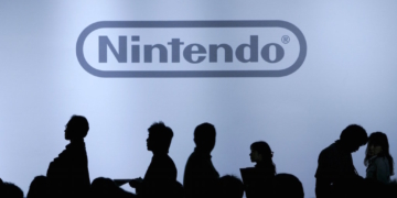 "Journalists are silhouetted during Nintendo Co Ltd's news conference in Chiba, east of Tokyo, in this October 10, 2007 file photo. Nintendo is expected to announce its Q1 results this week. REUTERS/Yuriko Nakao/Files  GLOBAL BUSINESS WEEK AHEAD PACKAGE - SEARCH ""BUSINESS WEEK AHEAD MAY 4"" FOR ALL IMAGES"